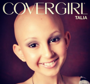 "magazine cover with a bald, nicely made up young caucasian girl with ""CoverGirl"" across the top. Close up of face with dark background"