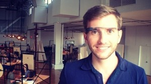 white young guy with scruffy facial hair wearing google glass