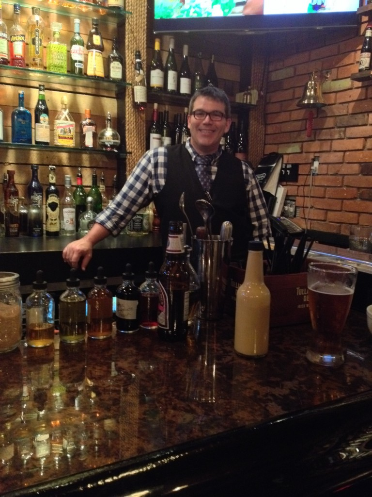 man standing behind the bar at Brick N Brew restaurant