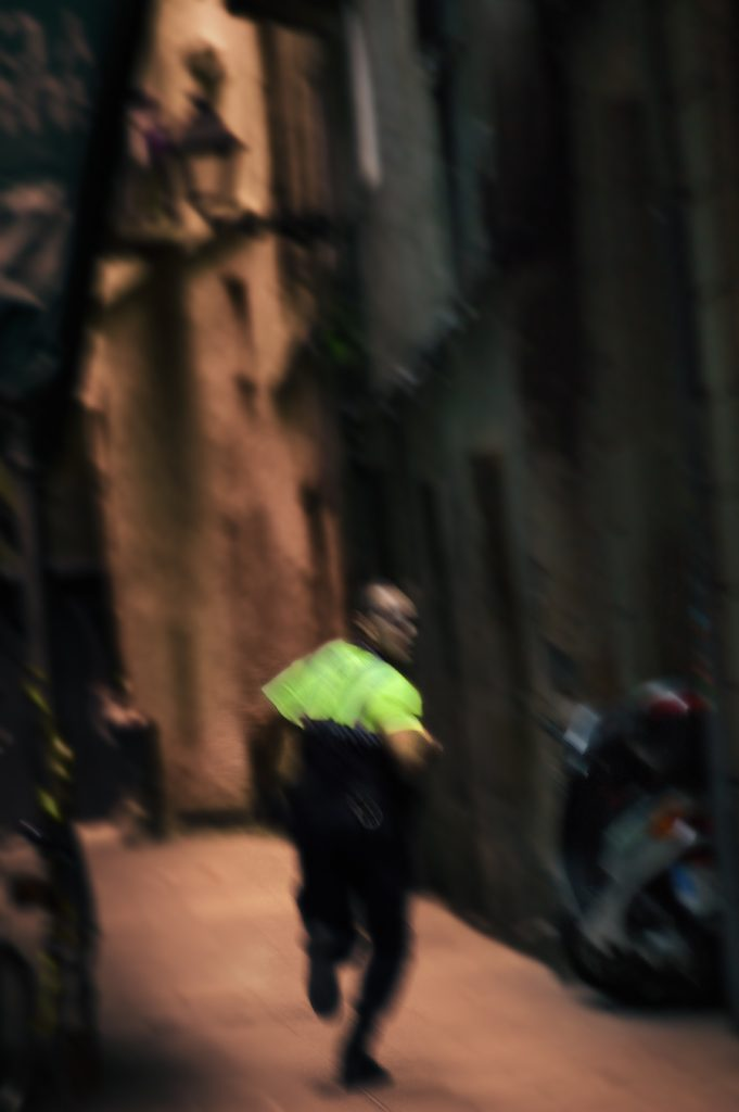 policeman running down alley