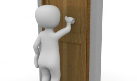 rounded 3-d stick figure all white/gray knocking on a non-descript wooden door